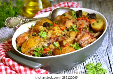 Rabbit baked with young potato in a cream.Rustic style.