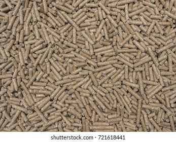 Rabbit feed pellets as background.