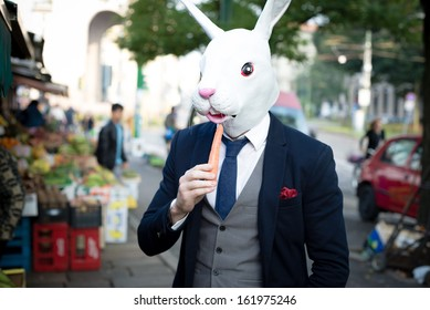 rabbit mask man with carrot in the city