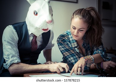 rabbit mask man and woman working at home