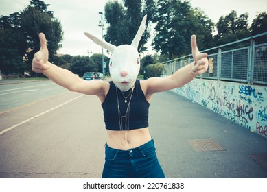 rabbit mask woman absurd unreal in the city