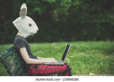 rabbit mask young lesbian stylish hair style woman using notebook in the city
