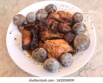 Rabbit in sauce with black potatoes