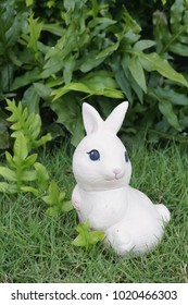 Rabbit statue. A cute bunny ceramic for garden decoration.