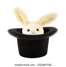 Rabbit toy appearing from a top hat isolated on white background