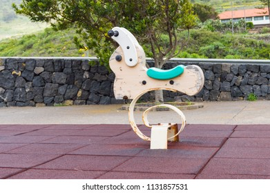Rabbit-shaped spring rocking games in a playground on the island of Tenerife