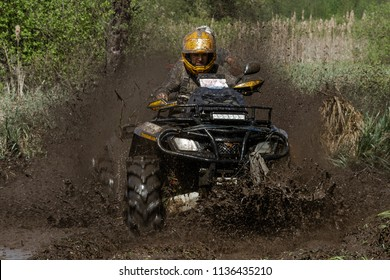Race ATV in the mud, off road