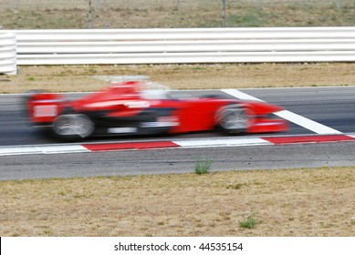 race car crosses the finish line