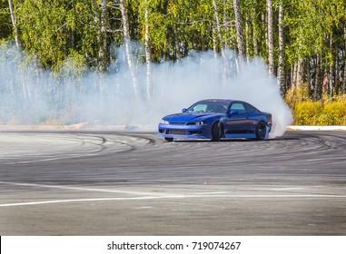 Race car drifting on speed track