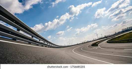 Race Car / motorcycle racetrack after rain on a sunny day. Fast motion blur effect. Ready to race