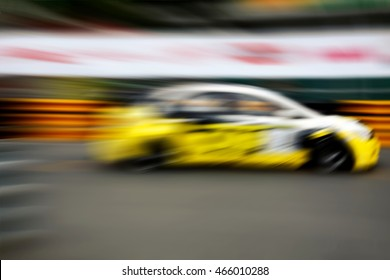 Race car racing on speed track with motion blur.