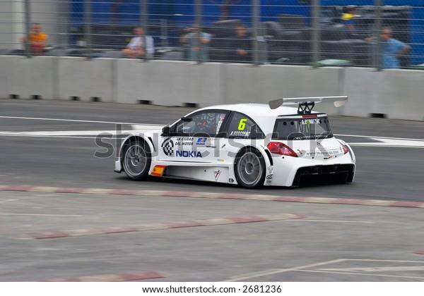 Race cars racing at the grand prix on urban circuit