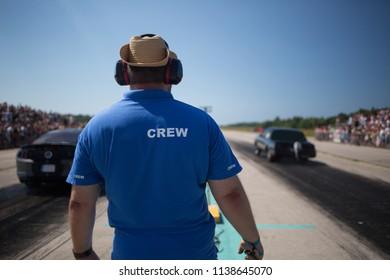 Race director on start line. Marshal of raceway give start dragrace