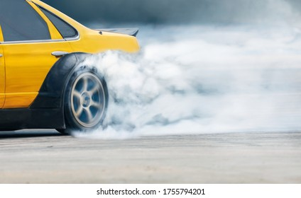 Race drift car burning tires on speed track