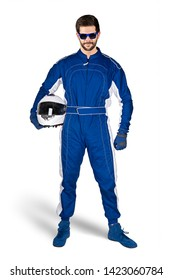 Race driver in blue white motorsport overall shoes gloves and safety gear crash helmet under his arm determined and ready to go isolated on white background. Car racing motorcycle sport concept.