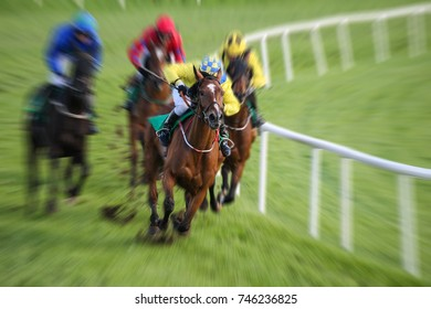 Race horses and jockeys racing motion blur