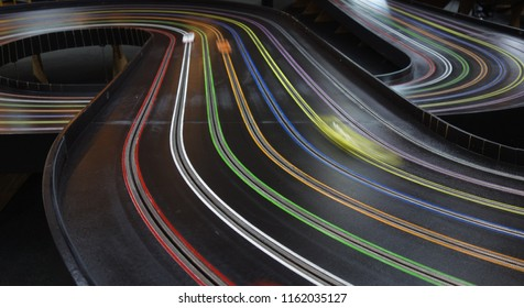 """Race on an 8 lane """"Blue King"""" slot car track with 3 racing cars. This kind of track is recognized for world records in 1:24 scale racing."""