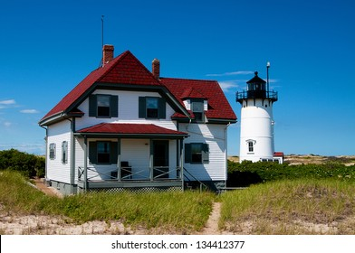 Race Point Lighthouse can be reached from hiking through soft sand. Visitors can also stay at the keeper's quarters and surrounding buildings.