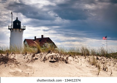 Race Point Lighthouse stands resilient as summer rain storm approaches. The beacon is located on the sands of the Cape Cod National Seashore.