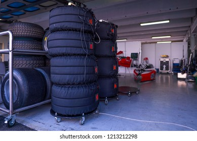 Race tires in warming blankets