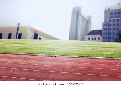 Race track against view of apartment with blue sky
