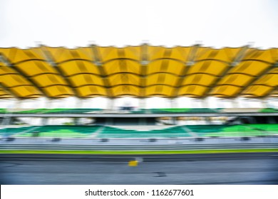 Race track with motion blur effect. Motorsports racing circuit background.