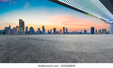 Race track road and bridge with city skyline at night in Shanghai.