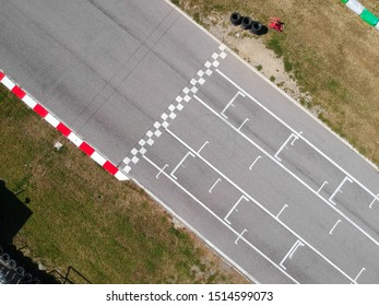 Race track with starting or end line, aerial view background