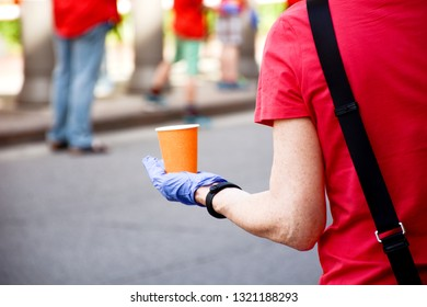 Race volunteer handing out water at a water station.