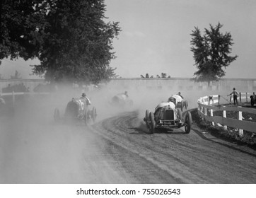 Racecars rounding a turn at the Rockville Fair auto races, August 25, 1923.