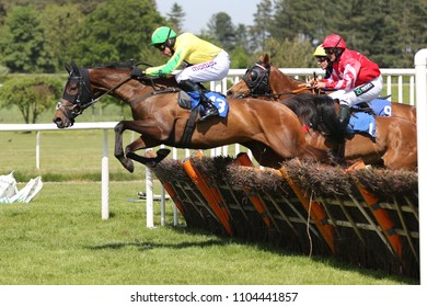 Racehorse Baron Von Chill ridden by Harry Skelton jumps the last fence before winning at Market Rasen Races : Market Rasen Racecourse, Lincolnshire, UK : 20 May 2018 : Pic Mick Atkins