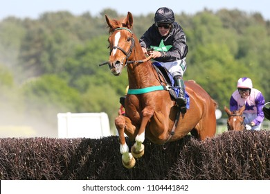 Racehorse Grow Nasa Grow ridden by Ryan Winks jumping steeplechase fence before winning at Market Rasen Races : Market Rasen Racecourse, Lincolnshire, UK : 20 May 2018 : Pic Mick Atkins