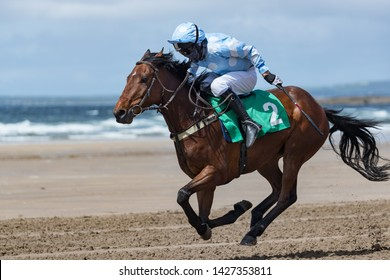 Racehorse and jockey, galloping on the beach,Horse racing action on the beach