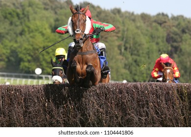 Racehorse Zamparelli ridden by Harry Skelton jumps last fence to win the 2m 3f Handicap Steeplechase at Market Rasen Races : Market Rasen Racecourse, Lincolnshire, UK : 20 May 2018 : Pic Mick Atkins