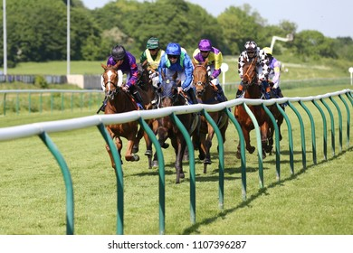 Racehorses galloping up against running rail whilst racing at Nottingham Races : Nottingham Racecourse, Nottingham, UK : 22 May 2018 : Pic Mick Atkins
