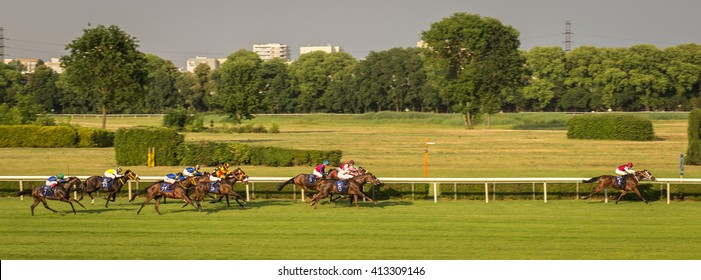 Racehorses With Jockeys During A Horse Race