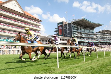 Racehorses race around the course in front of packed Grandstands at York Races on John Smiths Cup Day : The Knavesmire, York Racecourse, Nth Yorkshire, UK : 14 July 2018 : Pic Mick Atkins