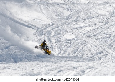 Racer snowmobile on a snowy mountainside. State Nature Reserve in Adygea, Russia.
