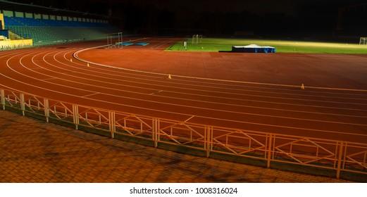 racetrack in night time. Stadium football. night scene. running arene.