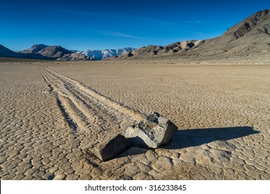 "The Racetrack Playa, or The Racetrack, is a scenic dry lake with ""sailing stones"" that inscribe linear ""racetrack"" imprints. It is located in Death Valley National Park, Inyo County, California, U.S."