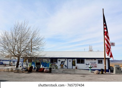 Rachel, Nevada, United States of America - November 21, 2017. Exterior view of Little A'Le'Inn hotel in Rachel, Nevada, with American flag, commercial properties and tree.