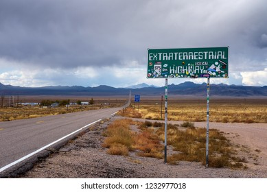 Rachel, Nevada, USA - October 22, 2018 : Road sign for the Extraterrestrial Highway covered with stickers. Close to the Nellis Air Force Range and Area 51, this road is popular among UFO hunters.