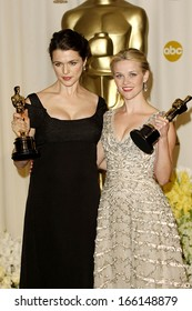 Rachel Weisz, Reese Witherspoon in the press room for OSCARS 78th Annual Academy Awards, The Kodak Theater, Los Angeles, CA, March 05, 2006