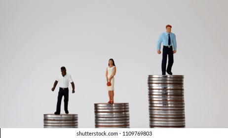Racial and economic inequality concepts. Miniaturepeoplestandingonpileofcoins.