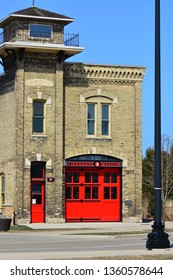 Racine, Wisconsin / USA - April 5, 2019: Firehouse Museum 3 with bright red doors on the antique building architecture.