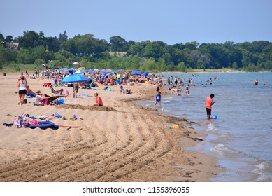 Racine, Wisconsin / USA - August 13, 2018: North Beach in Racine is loaded with patrons enjoying the cool Lake Michigan waters on a hot summer day.