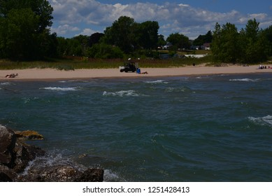 Racine, Wisconsin / USA - July 17, 2018:  The police make their rounds to keep North Beach safe for all on a hot summer day.