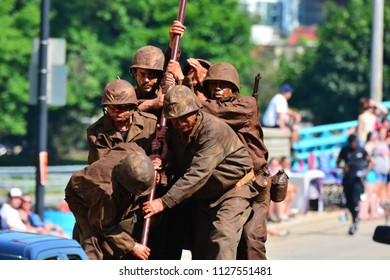 Racine, Wisconsin / USA - July,  2018: The Racine parade with the float of the Iwo Jima flag raising reenactment close up of soldiers.