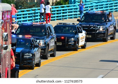 Racine, Wisconsin / USA - July 4, 2018: A line of Police vehicles start the Racine Parade.