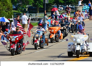 Racine, Wisconsin / USA - July 4, 2018: A large group of motorcyclists at the start of the Racine, WI Fourth of July Parade.